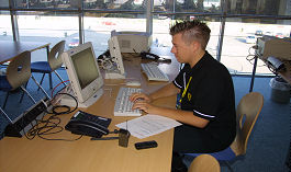 Abi @ work in the Press Office of the Ferrari Racing Days at the Nürburgring 2002
